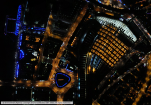 Night time aerial imagery of London Waterloo and the London Eye